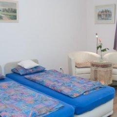 Апартаменты Deluxe Apartments комната для гостей фото 3