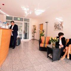 Отель Am Fasangarten Германия, Мюнхен - отзывы, цены и фото номеров - забронировать отель Am Fasangarten онлайн интерьер отеля