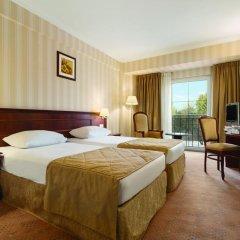 Ramada Hotel & Suites Bucharest North комната для гостей фото 4