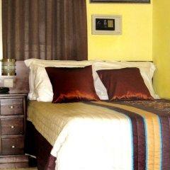 Отель Residencial Faria Guimarães сейф в номере
