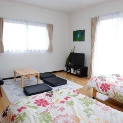 Отель Cottage Kutsuroki Япония, Якусима - отзывы, цены и фото номеров - забронировать отель Cottage Kutsuroki онлайн комната для гостей фото 3