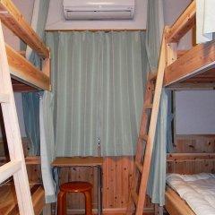 Отель Guesthouse Yakushima 2* Кровать в мужском общем номере фото 4