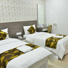 D'Metro Hotel 3* Стандартный номер с 2 отдельными кроватями фото 4