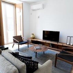 Апартаменты Flora Chiado Apartments Лиссабон комната для гостей
