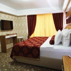 Grand Corner Boutique Hotel 4* Стандартный семейный номер с различными типами кроватей фото 2
