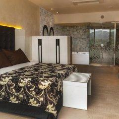 Отель Mas Tapiolas Suites Natura 4* Люкс с различными типами кроватей фото 10
