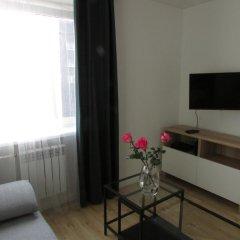 Апартаменты Уют комната для гостей фото 5