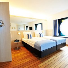 Отель ARCOTEL Onyx Hamburg сейф в номере