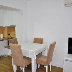 Отель Natea Apartments Албания, Тирана - отзывы, цены и фото номеров - забронировать отель Natea Apartments онлайн удобства в номере фото 2