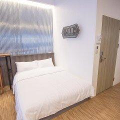 Отель Glur Bangkok Стандартный номер разные типы кроватей фото 18
