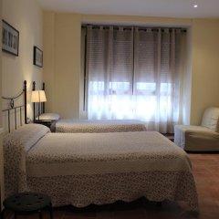 Отель Hostal El Pilar Стандартный семейный номер с двуспальной кроватью фото 5