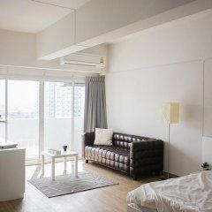 Апартаменты New Apg Apartments Бангкок комната для гостей фото 2