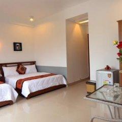 Hanh Dat Hotel Hue 3* Семейный номер Делюкс с двуспальной кроватью фото 4