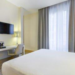 Отель NH Milano Touring 4* Улучшенный номер разные типы кроватей фото 27