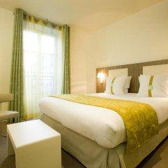 Отель Holiday Inn Paris Opéra - Grands Boulevards Франция, Париж - 10 отзывов об отеле, цены и фото номеров - забронировать отель Holiday Inn Paris Opéra - Grands Boulevards онлайн комната для гостей фото 2