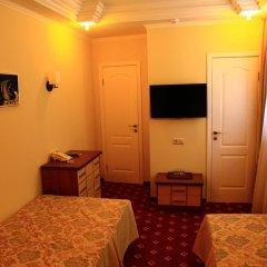 Мини-Отель Дюна Стандартный номер с 2 отдельными кроватями фото 4
