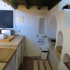 Отель A Casa Do Pássaro Branco в номере