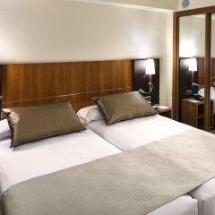 Отель Catalonia Barcelona Golf 3* Улучшенный номер с 2 отдельными кроватями