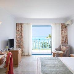 Отель Mitsis Rinela Beach Resort & Spa - All Inclusive 5* Стандартный номер с различными типами кроватей фото 7
