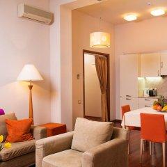 Апартаменты Arcada Apartments комната для гостей фото 4