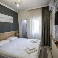 Гостевой Дом Лазурный Стандартный номер с двуспальной кроватью фото 10