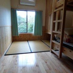 Отель Guesthouse Yakushima Якусима комната для гостей фото 2