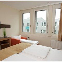 Отель Motel Plus Berlin 3* Стандартный семейный номер с различными типами кроватей фото 5