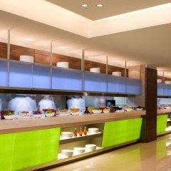 Traders Hotel Qaryat Al Beri Abu Dhabi, by Shangri-la питание фото 2