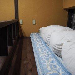 Отель Sudomari Minshuku Friend Якусима комната для гостей