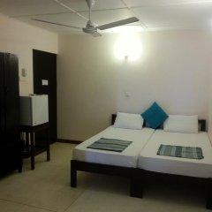 Отель Thiranagama Beach Hotel Шри-Ланка, Хиккадува - отзывы, цены и фото номеров - забронировать отель Thiranagama Beach Hotel онлайн комната для гостей фото 2