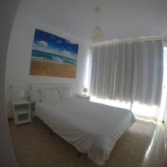 Апартаменты Mini Golf Apartments комната для гостей