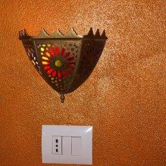 Отель Villa Beach City сейф в номере