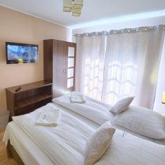 Апартаменты Visitzakopane Sky Apartments Закопане комната для гостей фото 2