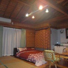 Отель Minnsyuku Yakushimaya Якусима комната для гостей
