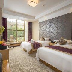 Отель Hangzhou Hua Chen International 4* Улучшенный семейный номер с двуспальной кроватью фото 8