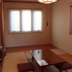 Отель La Isla Tasse Япония, Якусима - отзывы, цены и фото номеров - забронировать отель La Isla Tasse онлайн комната для гостей фото 3
