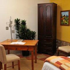 Отель Casa Xochicalco Гондурас, Тегусигальпа - отзывы, цены и фото номеров - забронировать отель Casa Xochicalco онлайн удобства в номере фото 2