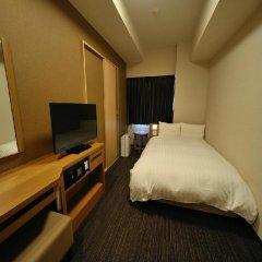 Отель Dormy Inn Tokyo-Hatchobori Natural Hot Spring 3* Стандартный номер с различными типами кроватей фото 2