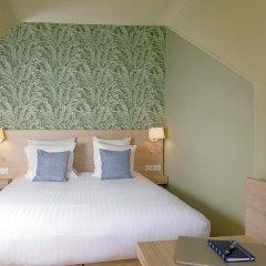 Отель Hôtel Du Centre 2* Стандартный семейный номер с двуспальной кроватью фото 11