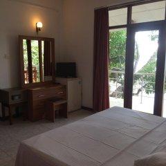 Отель Riverside Inn Fuji Шри-Ланка, Бентота - отзывы, цены и фото номеров - забронировать отель Riverside Inn Fuji онлайн удобства в номере