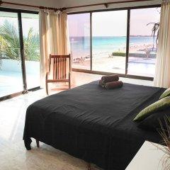 Отель Beachfront Villa комната для гостей