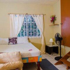 Отель Ackee Tree Sea View Villa Ямайка, Порт Антонио - отзывы, цены и фото номеров - забронировать отель Ackee Tree Sea View Villa онлайн комната для гостей фото 2