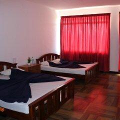 Отель Queens rest inn Стандартный семейный номер с двуспальной кроватью фото 4