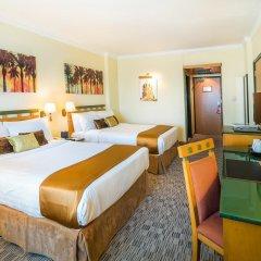 Отель Holiday International Sharjah Улучшенный номер с различными типами кроватей фото 2
