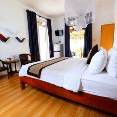 Отель An Bang Sunrise Beach Bungalow сейф в номере