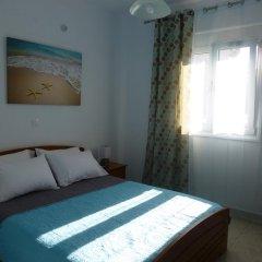 Апартаменты Pavloudis Apartments комната для гостей фото 3