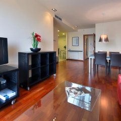 Апартаменты Habitat Apartments Fluvia Барселона комната для гостей фото 5