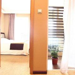Апартаменты Jietai Xingzheng Apartment комната для гостей фото 3