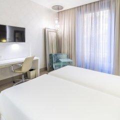 Отель NH Milano Touring 4* Улучшенный номер разные типы кроватей фото 29