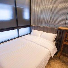 Отель Glur Bangkok Стандартный номер разные типы кроватей фото 39